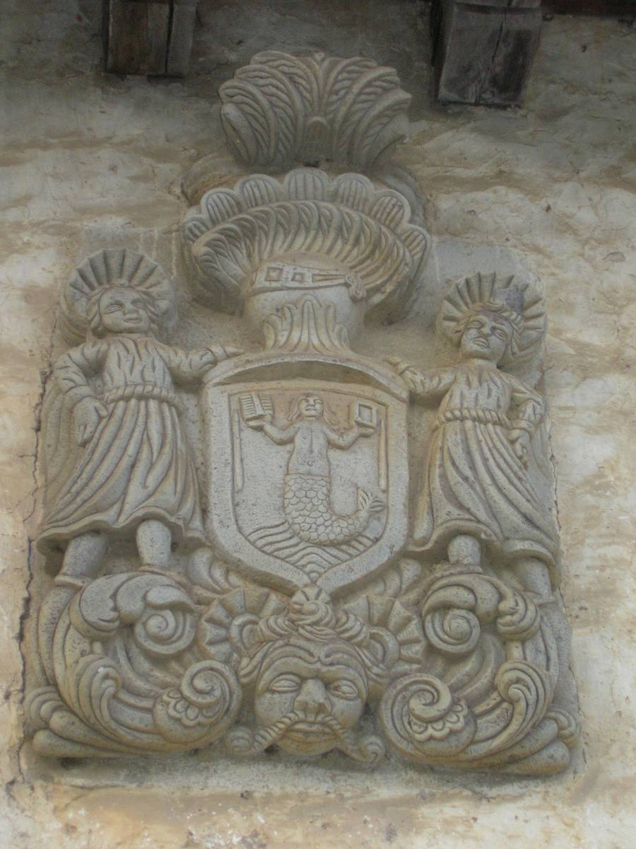 The lamia on a coat of arms on a house in Oriegi