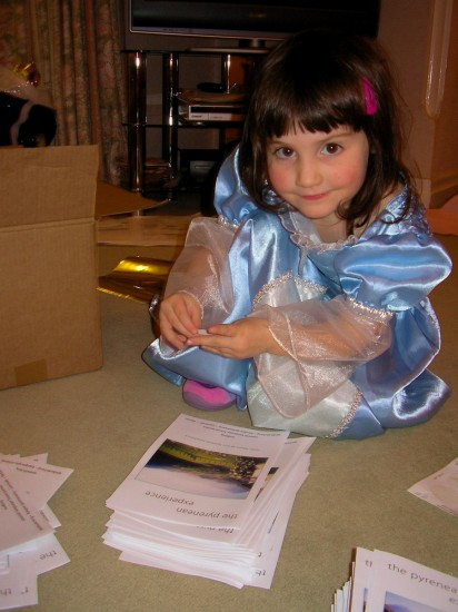 Marion, 3, on Christmas Day already working for our Spanish language company in the stamps and stickers department