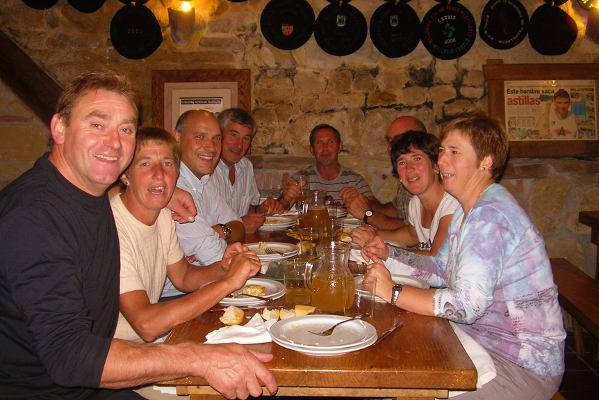 Basque friends at a cideria with Basque champion woodcutter 'Olasagasti'