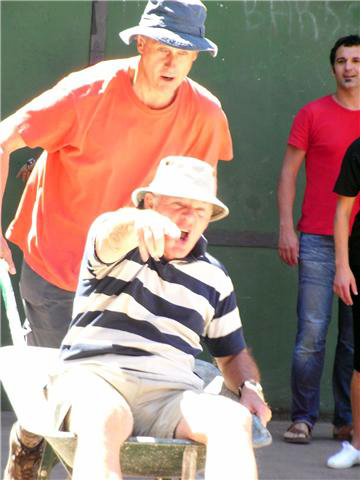 John and David in the wheel barrow race at Ituren village school