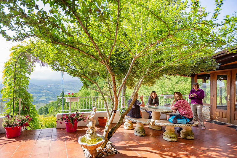 Pyrenean Experience talks on the terrace after Spanish lessons at the farmhouse