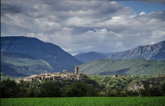 The village of Ainsa set in the mountains of the Pyrenees