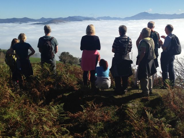 Walking group in the Basque Pyrenees above the mist